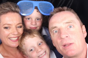 Martin and Nicole with kids in photo booth
