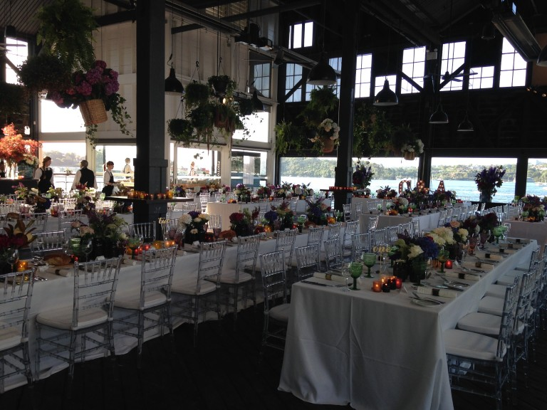 Tables and photo booth set at The Theatre Bar at Pier 4